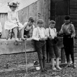 Black and white image of a group of four boys and one girl of President Beardshear's family and friends