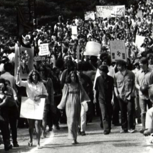 Black and white image protestors marching down Morrill Road near Memorial Union, May 1970