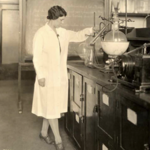 Septic early image of woman nutritionist standing next to lab with large beaker